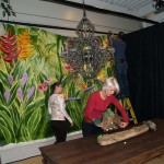 Members of the IFDA team install the mural and prep the table