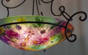 Sunflowers, roses, wildflowers and soft greens capture a spring morning in Jenny Floravita's new painted glass chandelier.