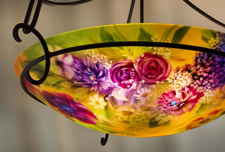 Summer Sunlight Flowers is an expressively painted sunflower and romantic flower themed reverse hand painted glass chandelier by artist Jenny Floravita with a warm sunny background color.