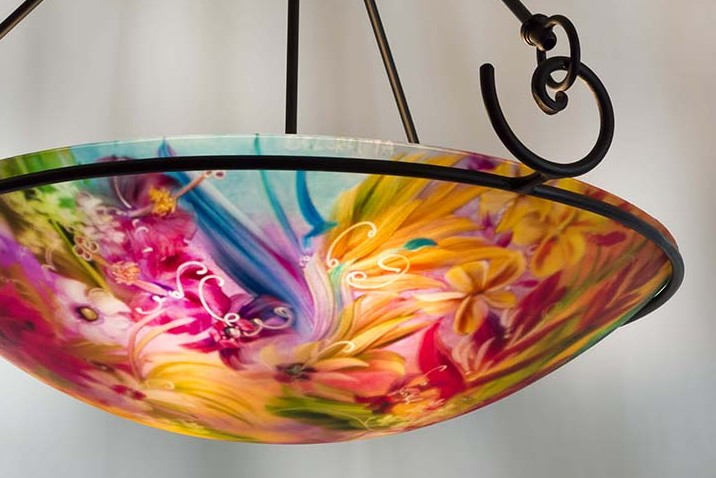 Tropical Paradise is a hand painted chandelier by Jenny Floravita. Forged fixture shown here is Floravita's Contemporary Swirl and has a height of 29 inches as pictured. This fixture style also comes in shorter heights. Installation ready.