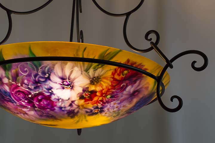 Roses, wildflowers and white accent flowers dance in the sunshine in Jenny Floravita's new painted glass chandelier.