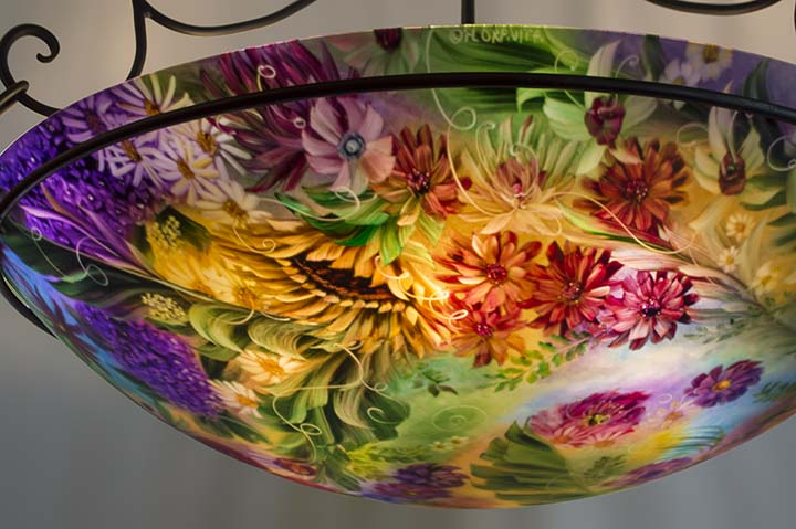 Romantic Flowers of New Orleans is a 44 inch commissioned reverse hand painted glass chandelier by artist Jenny Floravita.