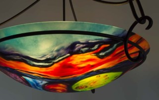 Sea gems and molten Hawaiian Lava take the scene in this exquisite 24 inch hand painted glass chandelier by artist Jenny Floravita a true work of art.